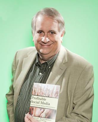 Warren Whitlock with book
